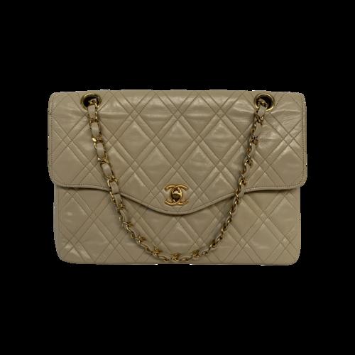 CHANEL Beige Lambskin Leather Bag